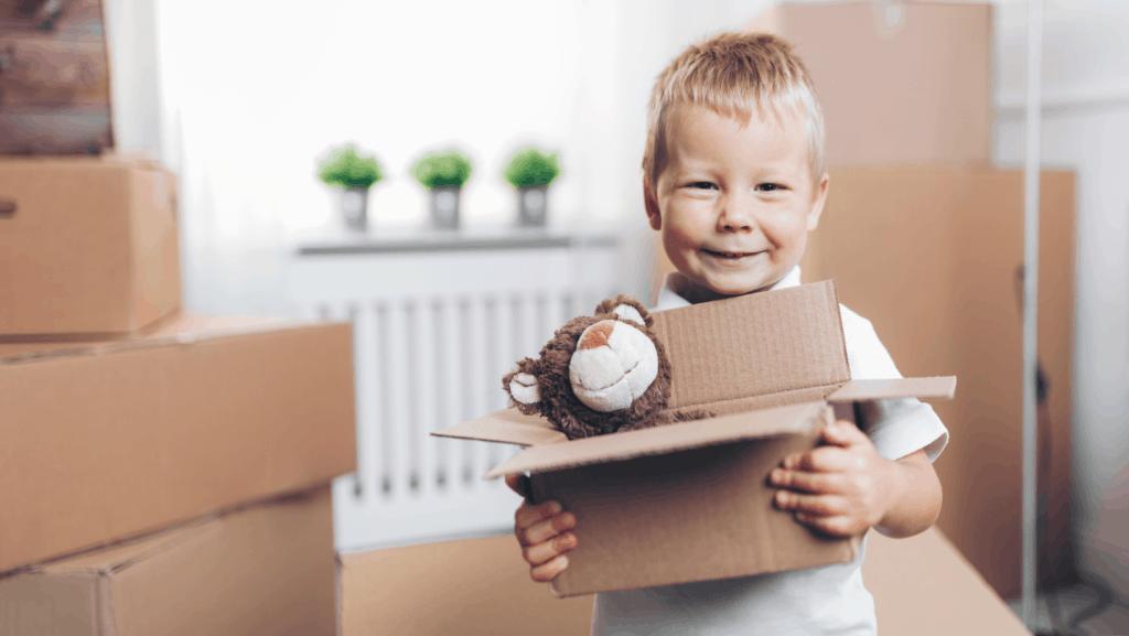 Little boy packing a box